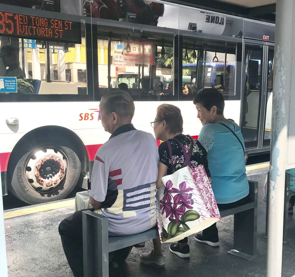people wait for a bus